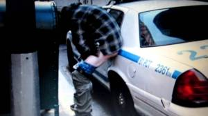 Occupy Wall Street Protester Defecating on a Police Car