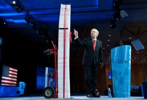 Mitch McConnell Standing Next To A Facsimile Of Obamacare In Print Form