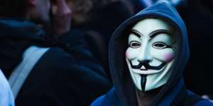 Person wearing a Guy Fawkes Mask