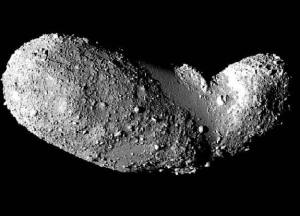 Asteroids, such as Itokawa, pictured here, are thought to be more like piles of rubble loosely clung together, than solid chunks of rock. Credit: ISAS/JAXA (Click for more info)