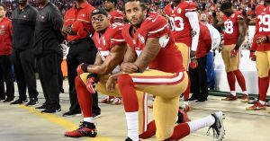 Colin Kaepernick and Eric Reid kneel during the national anthem prior to the 49ers' season opener.(Photo: Thearon W. Henderson, Getty Images)