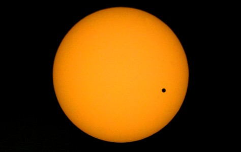 TEL AVIV, ISRAEL - JUNE 8: (ISRAEL OUT) The planet Venus is visible as a black dot as it transits across the face of the sun as seen from the Tel-Aviv university June 8, 2004 in Tel-Aviv, Israel. The rare astronomical event last occurred in 1882, while the next transit is due in 2012. (Photo by Uriel Sinai/Getty Images)
